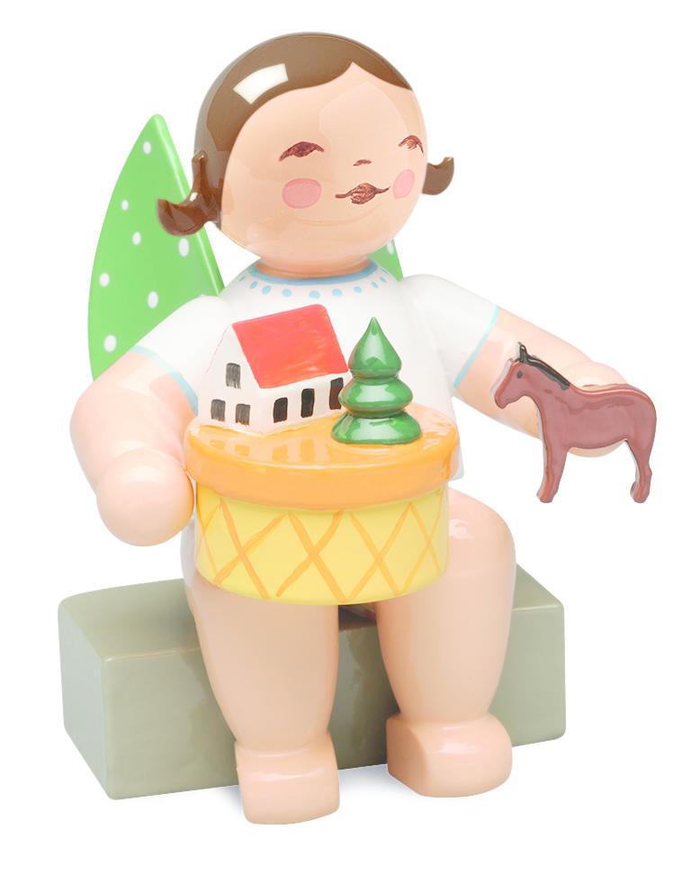 Engel met speelgoeddoos (donker) - zittend